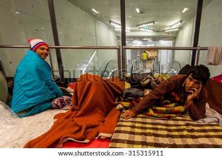 BUDAPEST - SEPTEMBER 7: war refugees waiting at Keleti Railway Station on 7 September 2015 in Budapest, Hungary. Refugees are arriving constantly to Hungary on the way to Germany. - stock photo