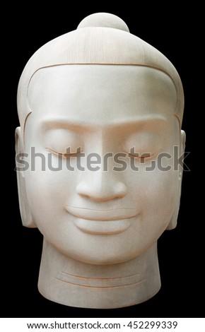 Buddah statue face against dark background. - stock photo