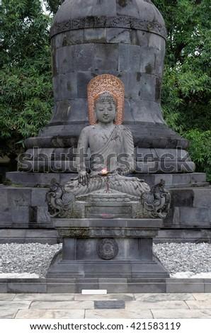 buddha aksobhya statue, in mendut buddhist monastery - stock photo