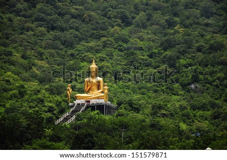Buddha among  great mountain in forest thailand - stock photo