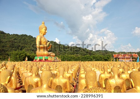 Buddha and disciple statues, Makabucha posture, Many buddha statue under blue sky in temple, Nakornnayok , Thailand - stock photo