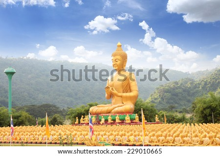 Buddha and disciple statues, Makabucha posture, Many buddha statue under blue sky in temple, Nakornnayok , Thailand - stock photo