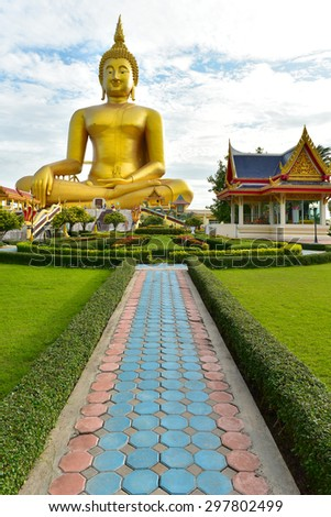Buddha and disciple statues, Makabucha posture, Many buddha statue under blue sky in temple, Angthong, Thailand - stock photo