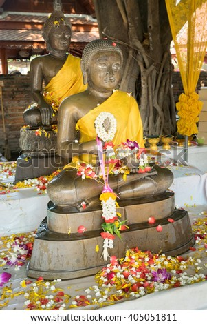 Buddha and jasmine garland and flowers in Songkran festival in Thailand - stock photo