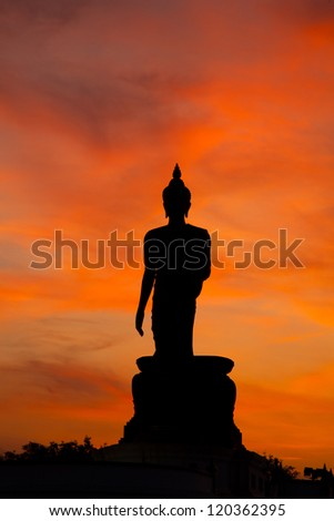 Buddha at sunset. When the evening sun is bright red. Lord Black is a sleek backlit.
