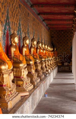 Buddha at Wat Arun, Bangkok travel gods of the Thai people. - stock photo