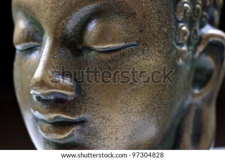 Buddha close up portrait on black - stock photo