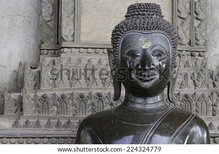 Buddha face in Vientiane, Laos - stock photo