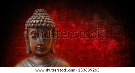 Buddha face on red and black, panorama - stock photo