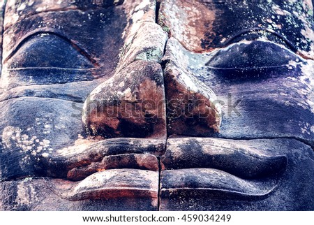 Buddha face. Stone murals and sculptures in Angkor wat, Cambodia. Buddhism concept. - stock photo