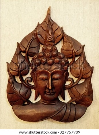 Buddha face surrounding by lotus flowers