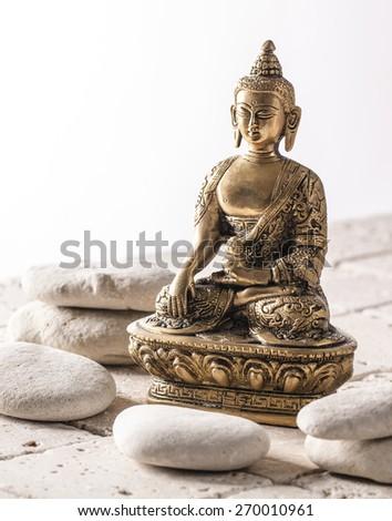 Buddha for zen attitude on mineral background - stock photo
