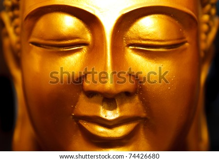 Buddha gold statue close-up - stock photo
