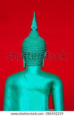 Buddha green statue on red background  - stock photo