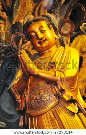 Buddha image at the Jade Buddha Temple in Shanghai, China. - stock photo