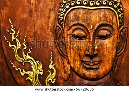 Buddha image in Thai style wood graving - stock photo