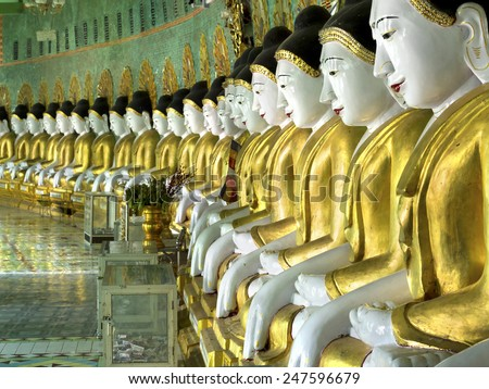 Buddha images inside U Min Thonze pagoda in Sagaing, Mandalay, Myanmar (Burma). - stock photo