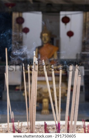 Buddha in a temple incense - stock photo