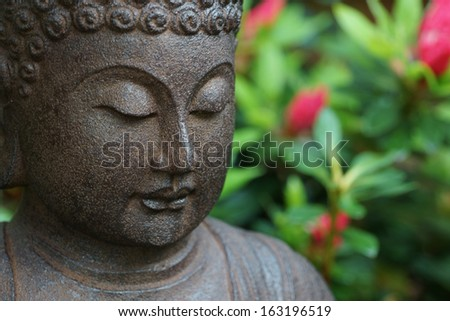 Buddha in garden - stock photo