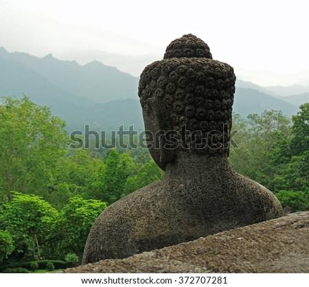 buddha in   the ninth century mahayana buddhist temple of borobodur,  in magelang, java, indonesia            - stock photo