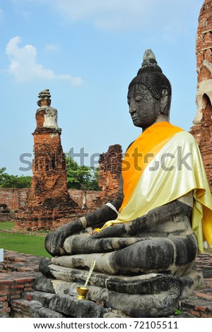Buddha in the ruin temple wat mahathat Thailand - stock photo
