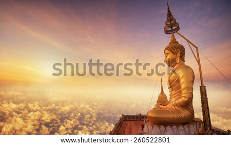Buddha in Wat Tham Seua (Tiger Cave), Krabi, Thailand with sunrise view - stock photo