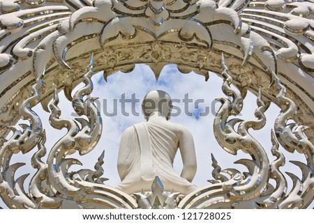 Buddha isolated against the bright sky - stock photo