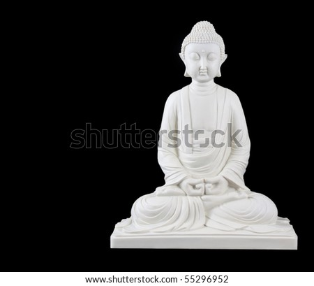 Buddha ornament isolated against a black background - stock photo
