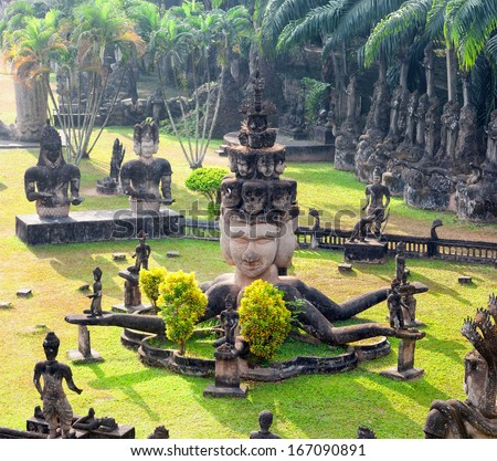 Buddha park in Vientiane, Laos. Famous travel tourist landmark of Buddhist stone statues and religious figures  - stock photo