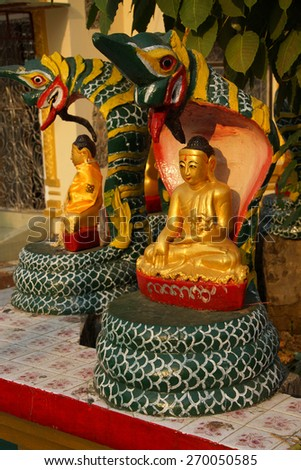 Buddha protected by the naga cobra serpent's hood,  Botataung Pagoda, Yangon,  Myanmar (Burma) - stock photo