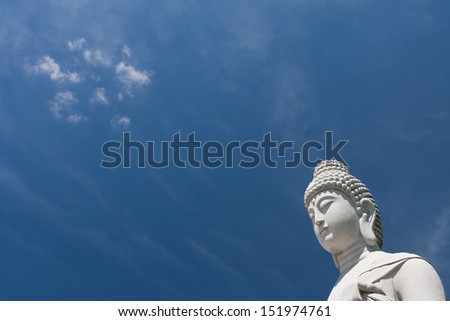 Buddha sculpture, great for Asia travel and religious themes with beautiful blue sky. - stock photo