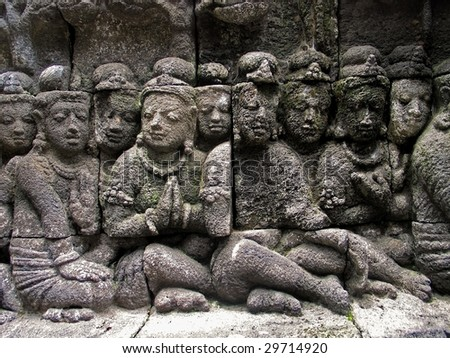 Buddha sculptures in a wall of Borobudur temple, Jogjakarta, Java, Indonesia. - stock photo
