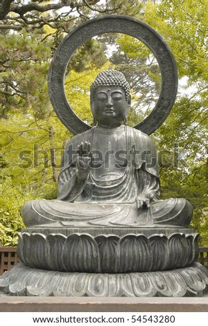 Buddha sitting in Japanese Garden