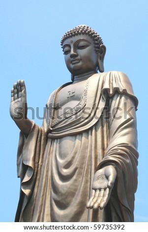 Buddha Statue, against Peaceful sky - stock photo