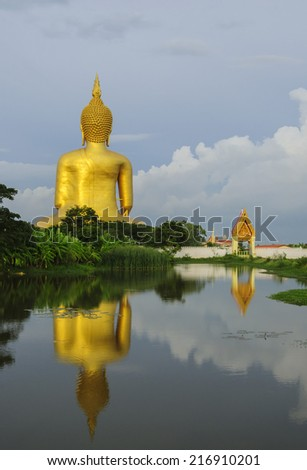 buddha statue and reflection  - stock photo