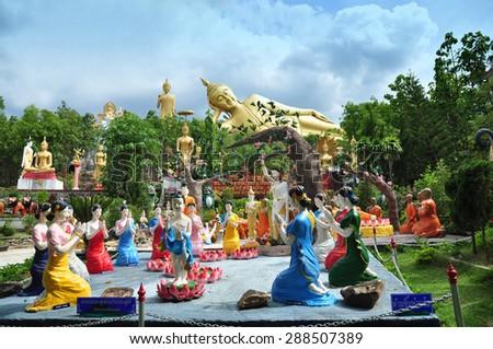 Buddha statue and The great Reclining Buddha - stock photo