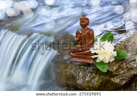 Buddha statue at a stream - stock photo
