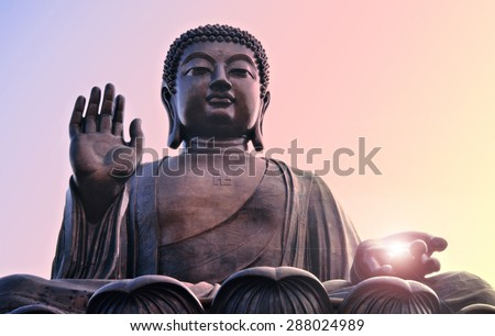 Buddha statue at Po Lin monastery Lantau island Hong Kong. Bright light source in hand. - stock photo