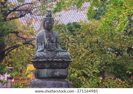 buddha statue at senso-ji temple in Asakusa, Tokyo, Japan - stock photo