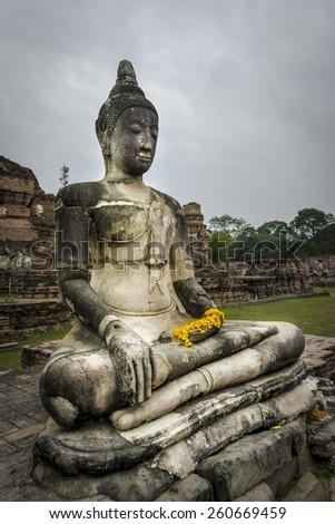 Buddha statue at Wat Phu Khao Thong temple in Ayutthaya. Thailand. - stock photo