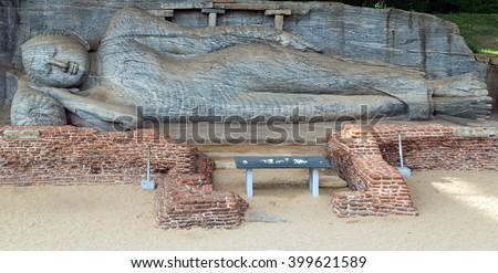 Buddha statue carved in to the rock in Gal Vihara, Sri Lanka, Ceylon, ancient city of Polonnaruwa, - stock photo