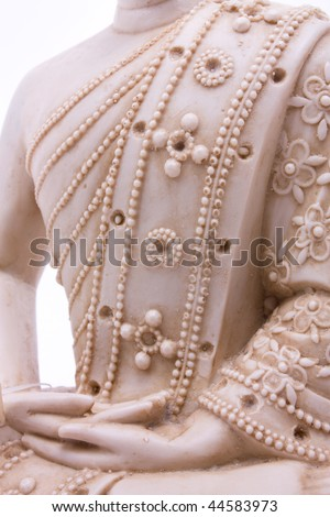 Buddha statue close up of hands against white background. - stock photo