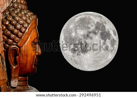 Buddha statue face and moon  - stock photo