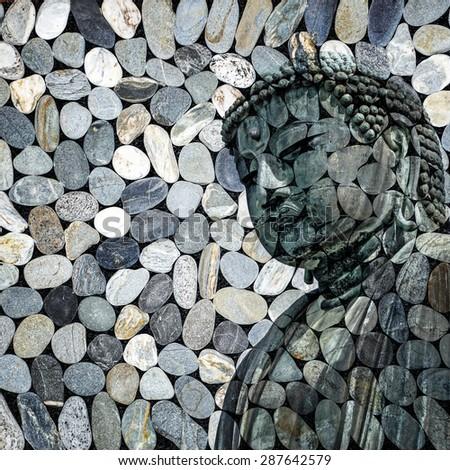Buddha statue, grey stones texture - stock photo