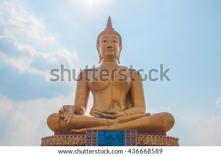 Buddha statue in blue sky - stock photo