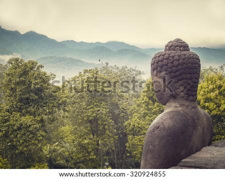 buddha statue in nature - stock photo