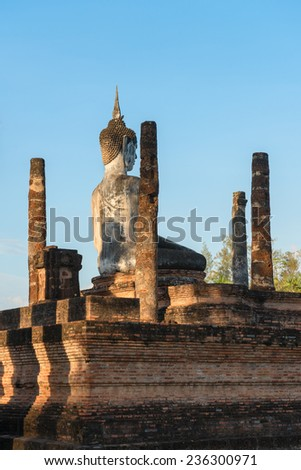 Buddha statue in old Buddhist temple ruins. Buddha statue in Sukhothai historical park Wat Mahathat. - stock photo