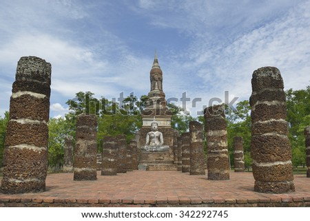 Buddha statue in old temple ruins. Sukhothai historical park Wat Mahathat. - stock photo
