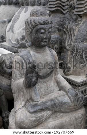 Buddha statue in Panjiayuan antique market, Beijing, China - stock photo