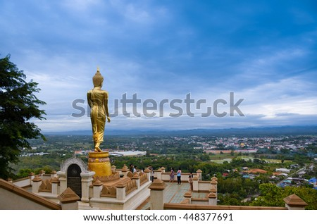 Buddha statue in temple, Nan, northern of Thailand, cloudy  - stock photo